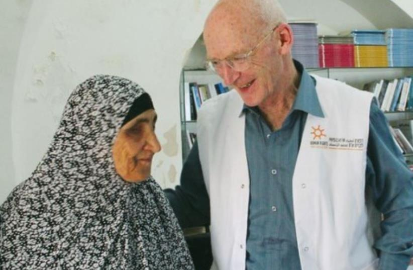 DR. WALDEN REASSURES a Palestinian woman after treating her and providing prescriptions. (photo credit: COURTESY ANDRÉ DEGON)
