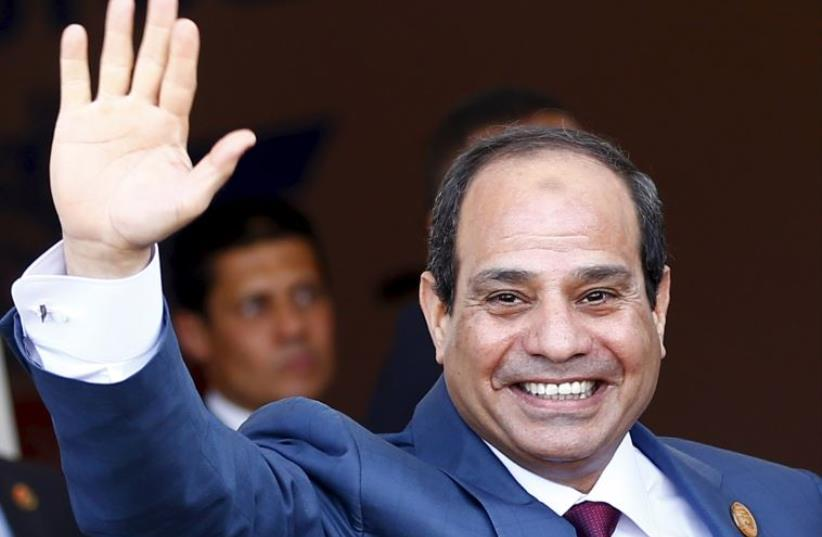 Egyptian President Abdel Fattah al-Sisi waves as he arrives to the opening ceremony of the New Suez Canal (photo credit: REUTERS)