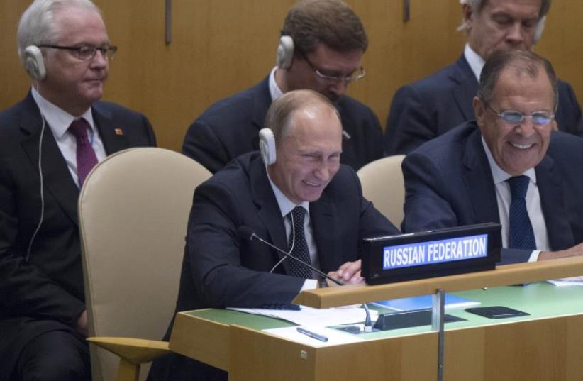 Russian President Vladimir Putin (L, front), Foreign Minister Sergei Lavrov (R, front), and members of the Russian delegation at the UNGA, September 28, 2015. (photo credit: REUTERS)