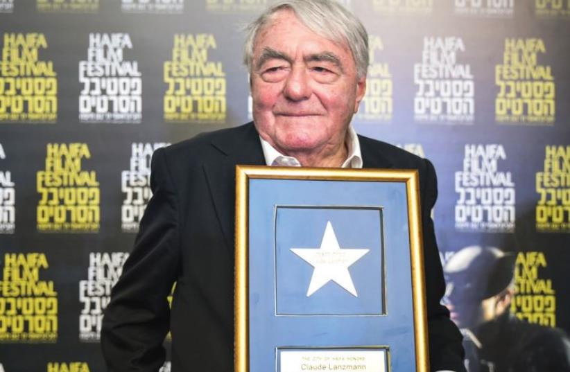 DOCUMENTARY FIMLMAKER Claude Lanzmann poses with his Lifetime Achievement Award at the 31st Haifa International Film Festival's opening ceremony (photo credit: GALIT ROSEN)