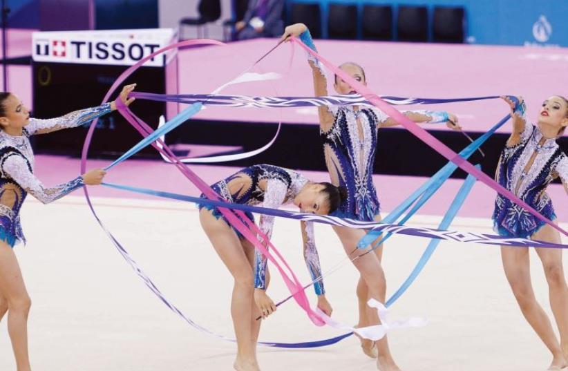 Israel's national rhythmic gymnastics team fashions a star of David (photo credit: OLYMPIC COMMITTEE OF ISRAEL)