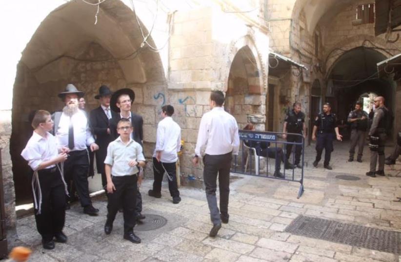 Haredim and police in Jerusalem, Old City (photo credit: MARC ISRAEL SELLEM)