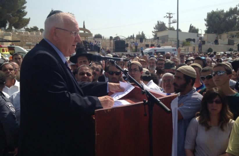President Reuven Rivlin speaks at the funeral of Eitam and Na'ama Henkin  (photo credit: GUSH ETZION REGIONAL COUNCIL)