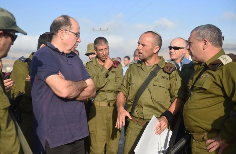 Defense Minister Moshe Ya'alon being briefed by security officials (photo credit: IDF SPOKESMAN'S UNIT)