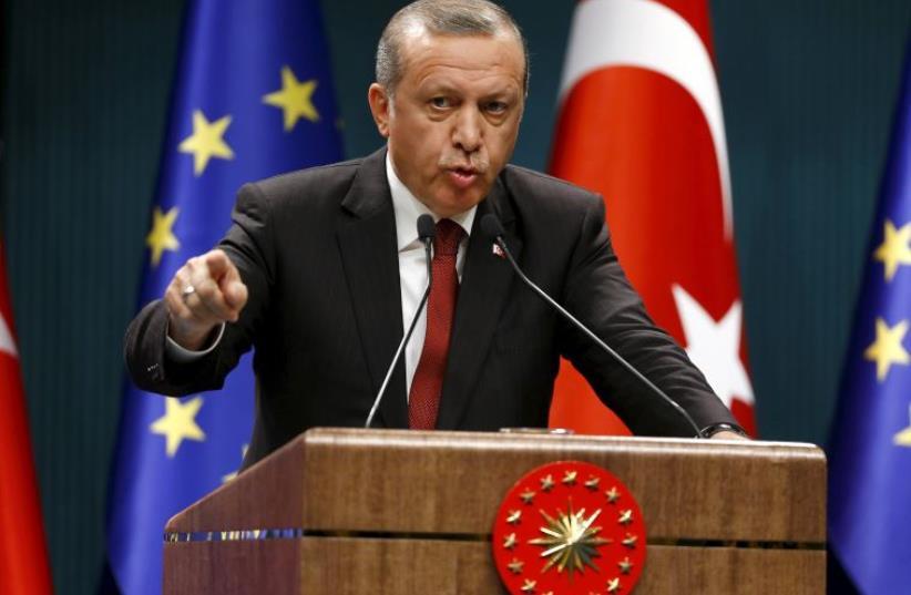 Turkish President Recep Tayyip Erdogan speaks during a news conference in Ankara (photo credit: REUTERS)