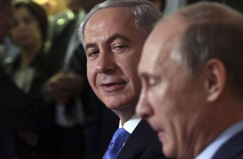 Russian President Vladimir Putin (R) and Prime Minister Benjamin Netanyahu attend a news conference in Sochi (photo credit: REUTERS)