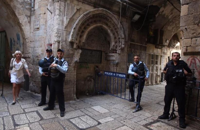 Police at a security barricade in the Old City of Jerusalem (photo credit: MARC ISRAEL SELLEM)