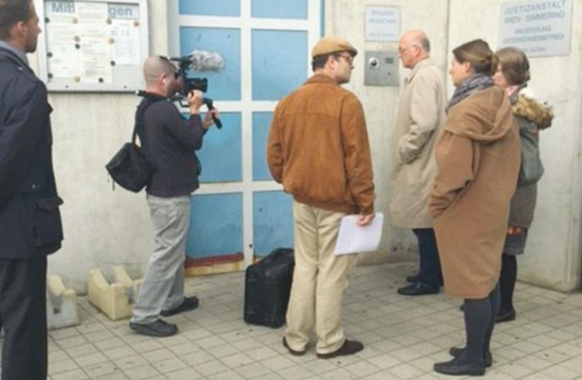 STEPHAN TEMPL (center) prepares to enter Simmering jail in Vienna (photo credit: STEPHANTEMPL.COM)