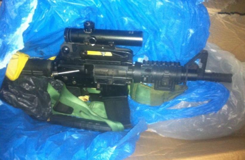 M-16 rifle used by terrorists in murder of Eitam and Naama Henkin. (photo credit: SHIN BET)