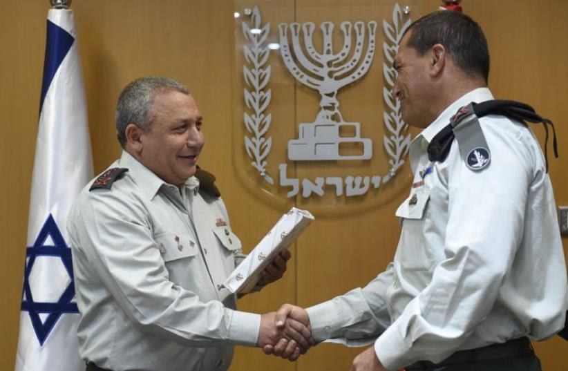 Newly appointed IDF Southern Command chief Maj.-Gen. Eyal Zamir (right) shakes hands with IDF Chief of Staff Lt.-Gen. Gadi Eisenkot. (photo credit: IDF SPOKESMAN'S UNIT)