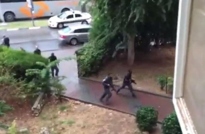 Police pursue terror suspect who snatched soldier's weapon (photo credit: screenshot)
