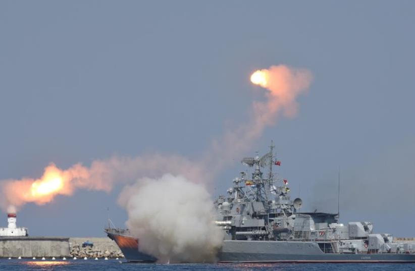 A Russian warship fires [File] (photo credit: REUTERS)
