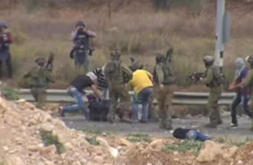 Undercover forces arrest rioting Palestinians near Ramallah  (photo credit: PALESTINIAN MEDIA)