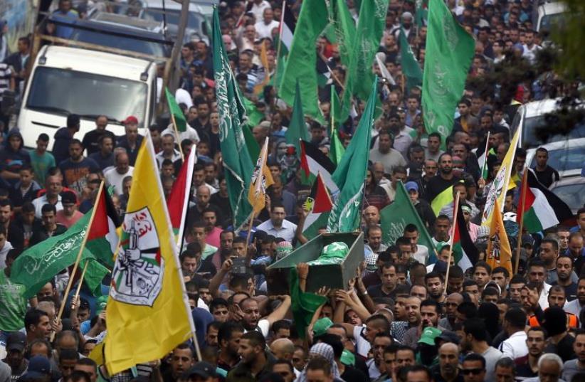 Funeral in the Shuafat refugee camp in east Jerusalem, on October 10, 2015 (photo credit: AHMAD GHARABLI / AFP)