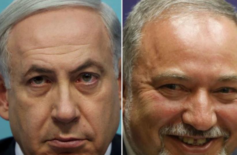 Prime Minister Benjamin Netanyahu (L) and Yisrael Beytenu chief Avigdor Liberman (photo credit: AFP PHOTO)