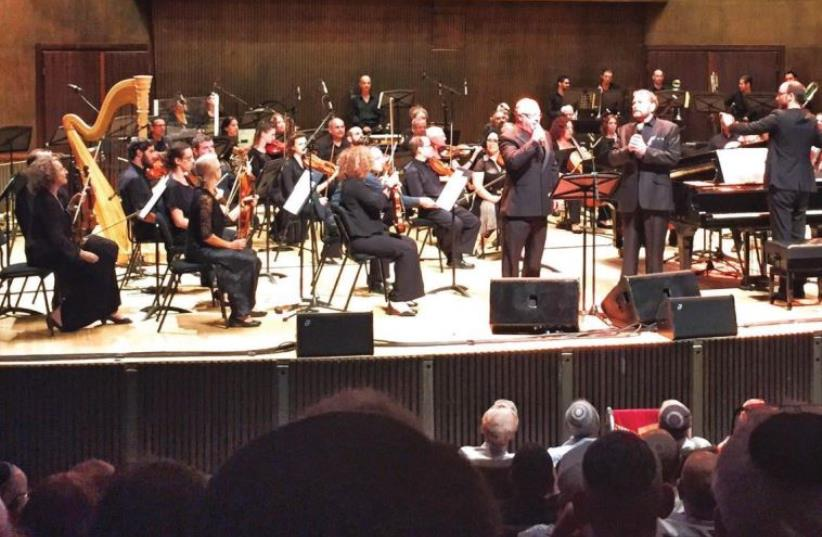 DUDU FISHER and Colin Schachat perform with the Jerusalem Symphony Orchestra conducted by Tomer Adaddi. (photo credit: Courtesy)
