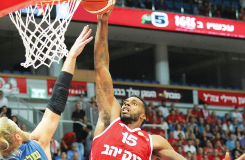 Hapoel Jerusalem forward Donta Smith goes up for a dunk in a game against Maccabi Ashdod (photo credit: DANNY MARON)