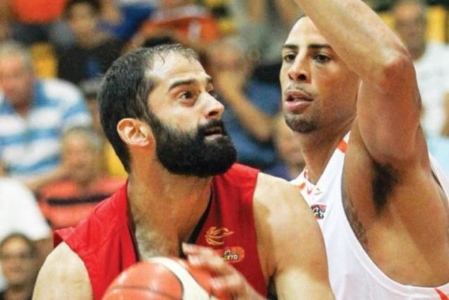 Hapoel Tel Aviv center Robert Rothbart (left) had 12 points and seven rebounds in last night's 82-66 win over Ironi Ness Ziona and Diamon Simpson (right). (photo credit: DANNY MARON)