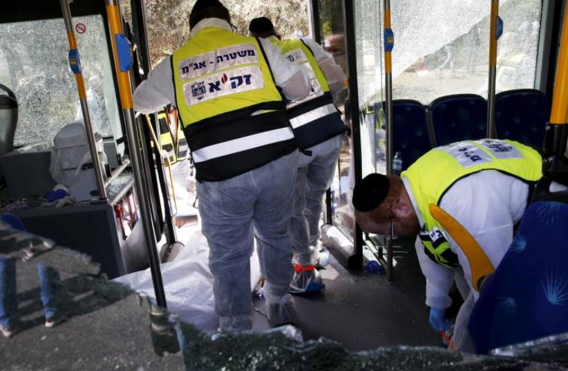 Members of Zaka Rescue and Recovery team at the scene of terror attack in Armon Hanatziv, Jerusalem (photo credit: REUTERS)