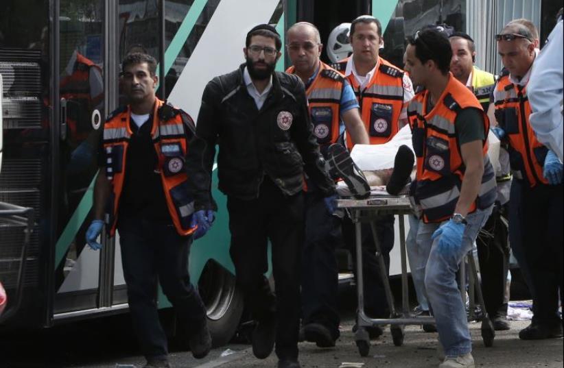 Scene of terror attack in Armon Hanatziv (photo credit: GALI TIBBON / AFP)