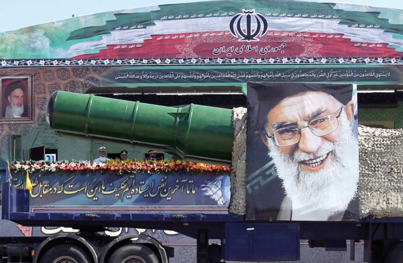A MILITARY truck carrying a missile and a picture of Iran's leader Ayatollah Ali Khamenei drives in a parade marking the anniversary of the Iran-Iraq war in Tehran (photo credit: REUTERS)