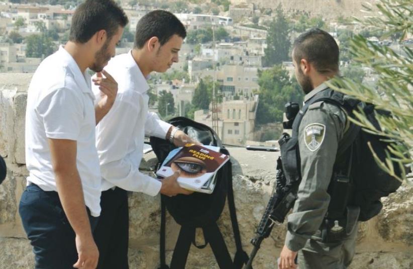 Police search two Arab students in east Jerusalem (photo credit: SETH J. FRANTZMAN)