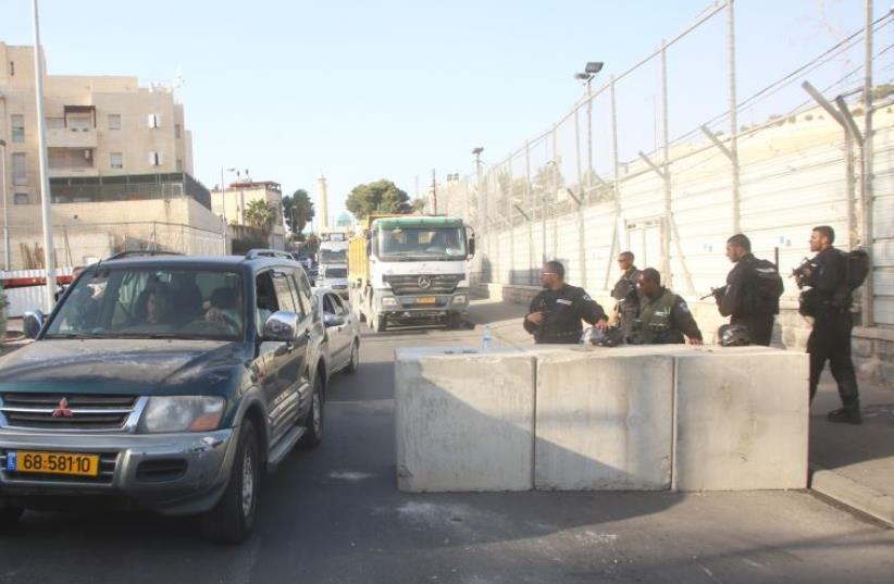 Concrete barriers set up in east Jerusalem neighborhoods (photo credit: MARC ISRAEL SELLEM/THE JERUSALEM POST)