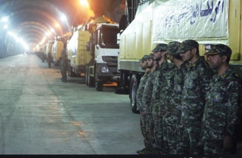 SOLDIERS OF the Revolutionary Guards Corps stand at attention in an underground missile facility recently revealed on Iranian state television. (photo credit: FARS)