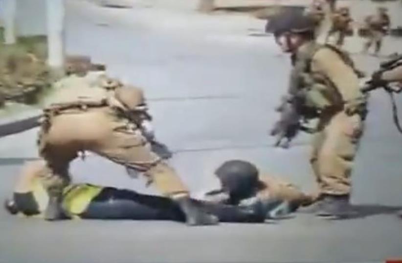 Hamas-run TV footage of attack in which a terrorist disguised as journalist stabs an IDF soldier near Kiryat Arba (photo credit: SCREENSHOT PALESTINIAN MEDIA)