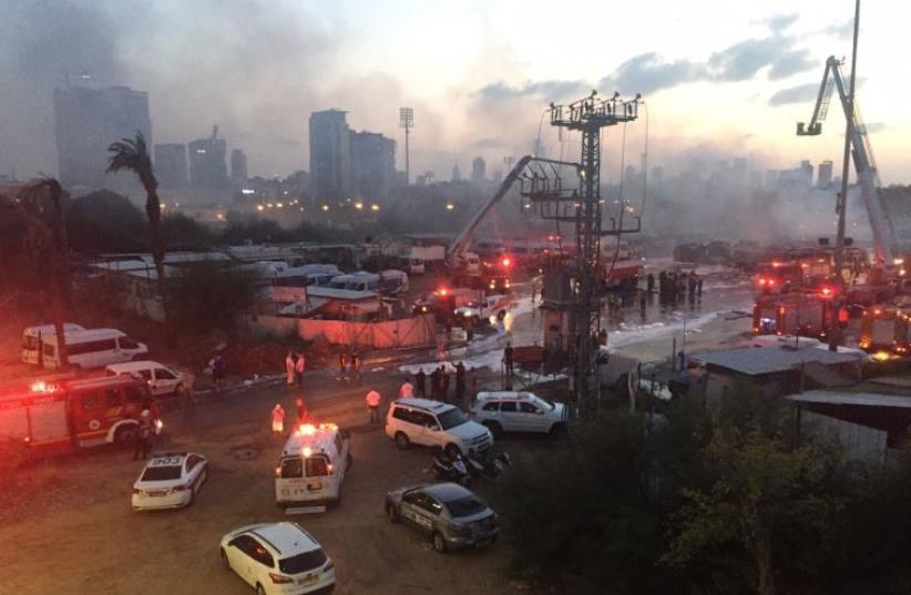Firefighters control blaze at Dan bus company parking lot (photo credit: ALONI MOR)