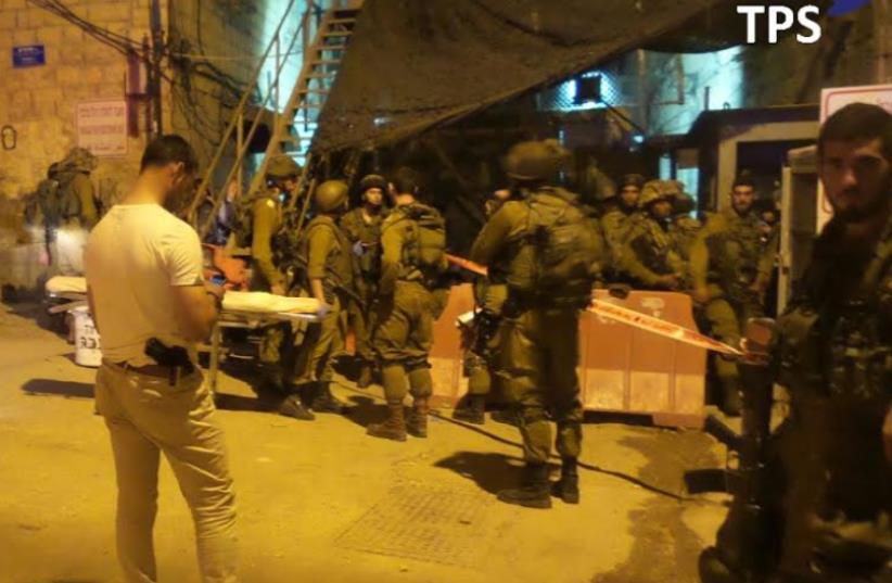Terrorst stabbing in Hebron (photo credit: TAZPIT)