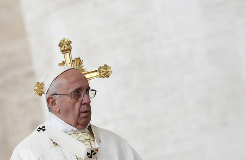 Pope Francis leads the mass for the canonization in Saint Peter's Square at the Vatican (photo credit: REUTERS)