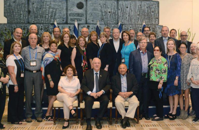 PRESIDENT REUVEN RIVLIN poses at the President's Residence in Jerusalem yesterday with a delegation of the Jewish Federations of North America. (photo credit: Mark Neiman/GPO)