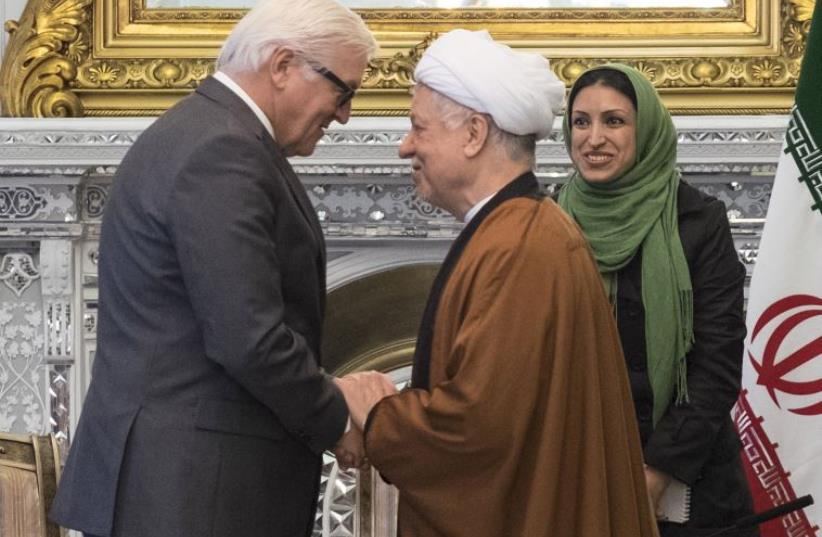 Chairman of Iran's Expediency Council Ali Akbar Hashemi Rafsanjani (R) shakes hands with German Foreign Minister Frank-Walter Steinmeier in Tehran (photo credit: REUTERS)