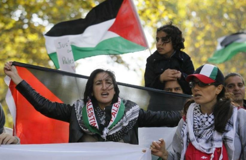 Pro-Palestine demonstrators calling for a boycott during a protest in Paris (photo credit: AFP PHOTO)