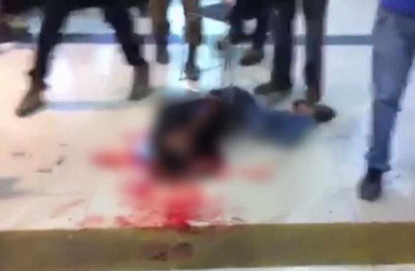 Israeli crowd beat Eritrean migrant mistakenly identified as Palestinian terrorist (photo credit: screenshot)