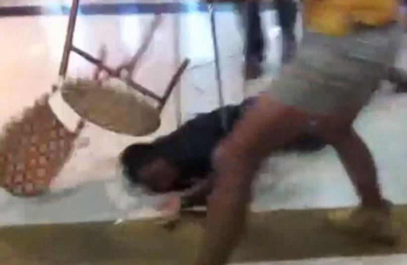 Israeli crowd beat Eritrean migrant mistakenly identified as Palestinian shooter (photo credit: screenshot)