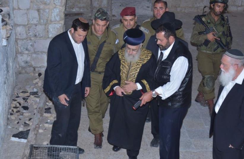 Chief Rabbi Yosef Yitzhak visits desecrated Joseph's Tomb (photo credit: MEIR BRACHIA)