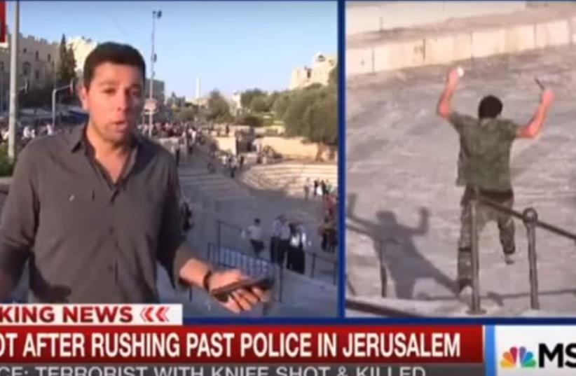 MSNBC News Journalist Ayman Mohyeldin Being Corrected During Report in Israel (photo credit: screenshot)