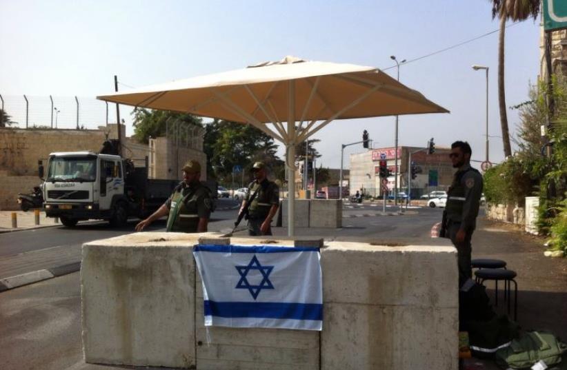 POLICE GUARD a checkpoint set up in Abu Tor on Monday (photo credit: JERUSALEM POLICE)