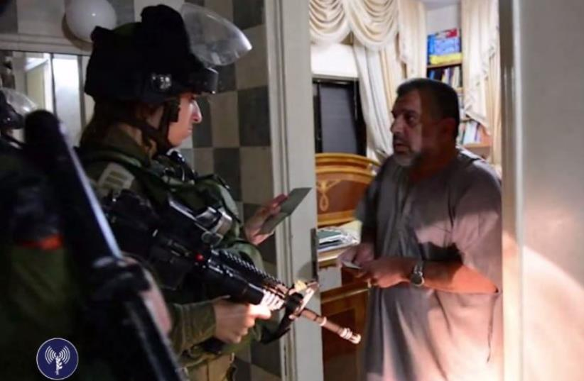 IDF soldiers arrest senior Hamas official Hassan Yousef (photo credit: screenshot)