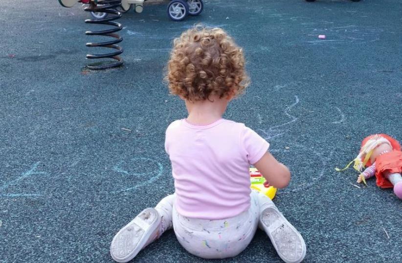A toddler at a playground in Tel Aviv (photo credit: BEN HARTMAN)