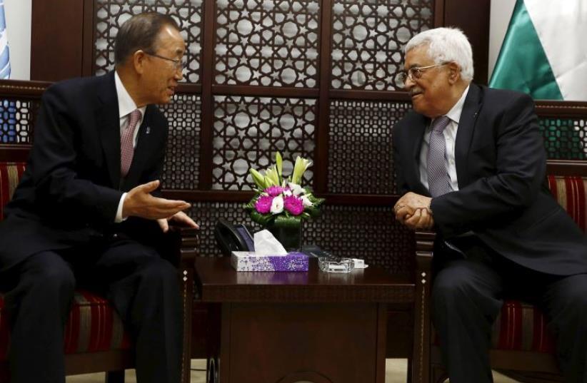 Palestinian Authority President Mahmoud Abbas (R) meets UN Secretary-General Ban Ki-moon in Ramallah October 21, 2015.  (photo credit: REUTERS)