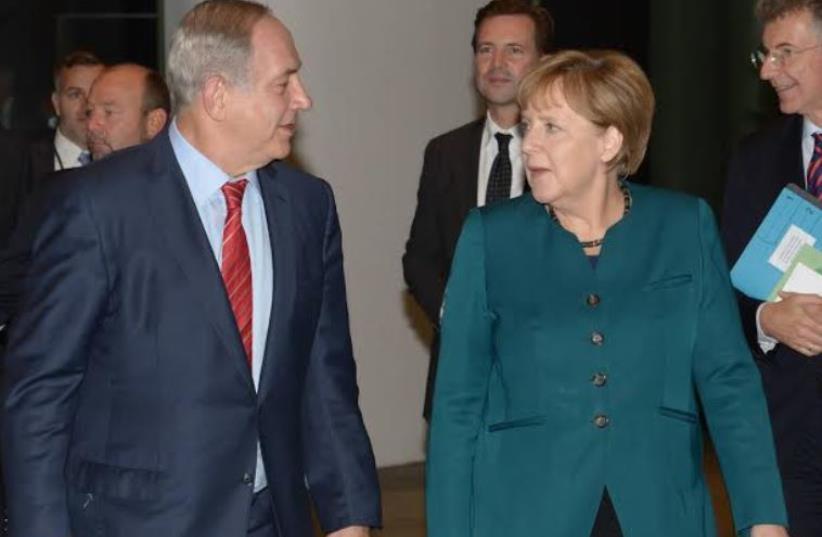 German Chancellor Angela Merkel with Prime Minister Benjamin Netanyahu in Berlin, October 21, 2015 (photo credit: AMOS BEN GERSHOM, GPO)