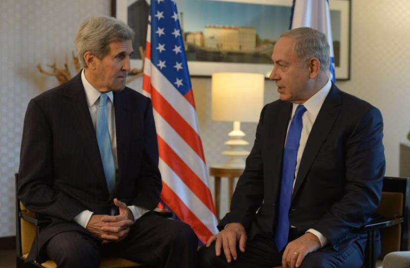 Netanyahu and Kerry meeting in Berlin (photo credit: AMOS BEN-GERSHOM/GPO)