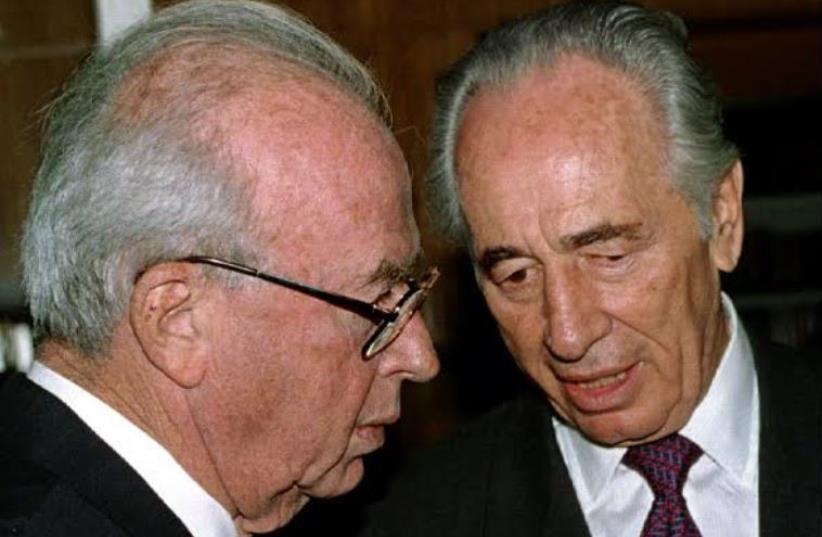 Yitzhak Rabin (left) with Shimon Peres  (photo credit: REUTERS)