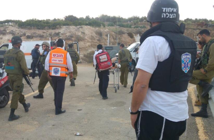 Emergency medical teams at terror scene in Gush Etzion (photo credit: HAZALA)