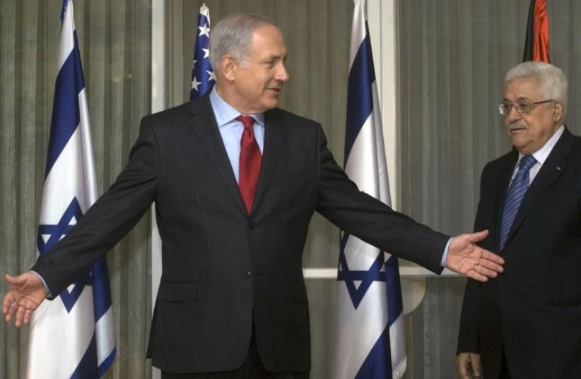 srael's Prime Minister Benjamin Netanyahu (L) gestures beside Palestinian President Mahmoud Abbas before their meeting in Jerusalem September 15, 2010 (photo credit: REUTERS)