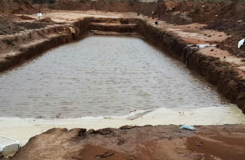 Water floods 1,500-year-old winepress unearthed in area once known for wine production‏ (photo credit: Israel Antiquities Authority)