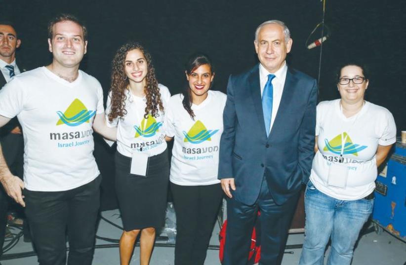 PRIME MINISTER Benjamin Netanyahu poses with participants in the MyMasa Event in Jerusalem last night. (photo credit: ELIRAN AVITAL)